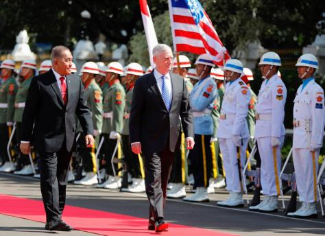 Visiting U.S. Secretary of Defense Jim Mattis reviews the honour guard with Indonesia's Defence Minister Ryamizard Ryacudu at the Defence Ministry in Jakarta, Indonesia