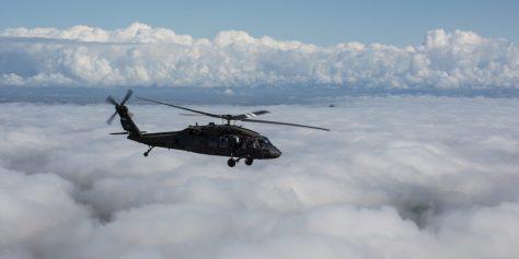 Black Hawk soars over clouds