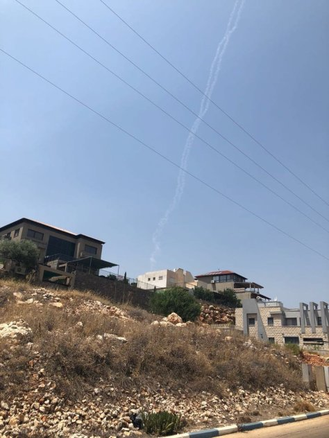 Smoke trails from two Patriot missiles, which the Israeli military said it had fired at a Syrian fighter jet, could be seen near Safed in northern Israel. Credit Reuters