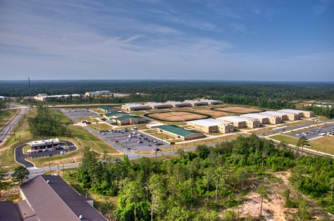 Aerial photos of Fort Benning's Digital Multi-Purpose Range Complex and Combined Arms Collective Training Facility taken in May 2011. The DMPRC opened in late 2010. (Photo by MCoE PAO Ph