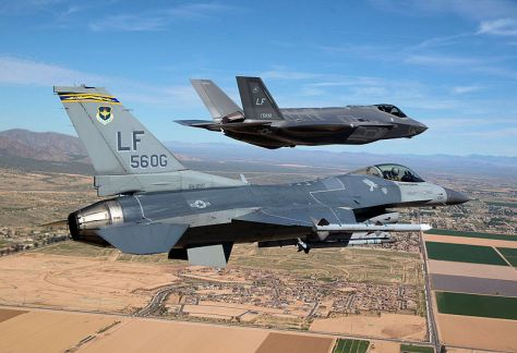 F-16 Fighting Falcon (84-1297) as he escorts Luke Air Force Base's first F-35 Lightning II (10-5030) to the base March 10, 2014. (Wiki)
