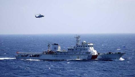 Kapal penjaga pantai Tiongkok mengadakan latihan SAR di Laut Cina Selatan, pada 14 Juli 2016. (Reuters)